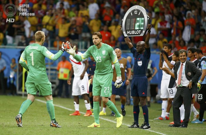 Goalkeeper Tim Krul of the Netherlands substitutes Jasper Cillessen during extra time in the 2014 World Cup quarter-finals between Costa Rica and the Netherlands at the Fonte Nova arena